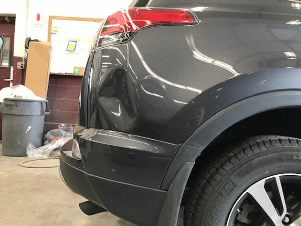 Before Large Dent Removed